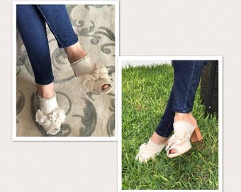 Cute shoes model mules. Elaborate on raw canvas with wood heel and knot. Perfect for the summer and autumn.