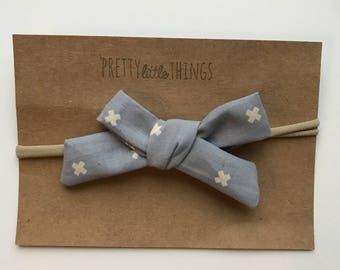 Hand Tied Bow in grey-blue with cross pattern - nylon headband or clip
