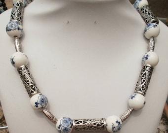121 - White flower ceramic Bead Necklace blue