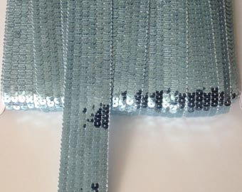 Round blue glitter ribbons sold in 6 rows sky has cut for making Tote