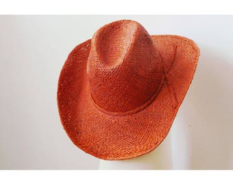 Sun Hat, tooled, finely handwoven raffia with a bow on the side, orange