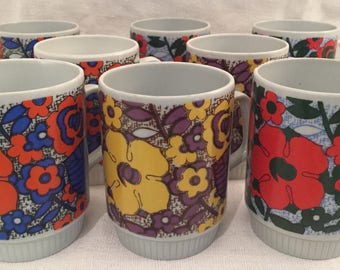 Set of 8 psychedelic German mugs.