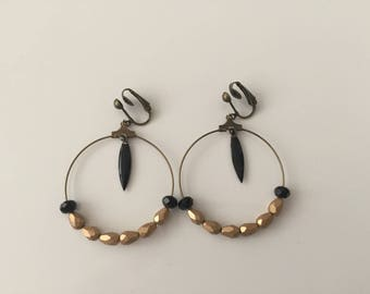 Gold and black pearl earrings