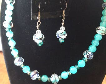 Teal beaded necklace and earring set with decorative station beads, in teal and blue,