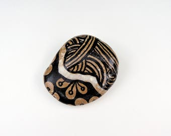 Pebble paperweight with graphics