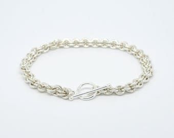 Silver coloured 2x2 link chain mail bracelet with t bar clasp. 8 inches Long