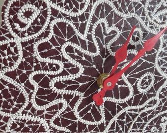 Wall clock. Handmade. Lace imitation design.