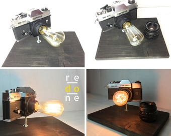 Carena Camera Lamp