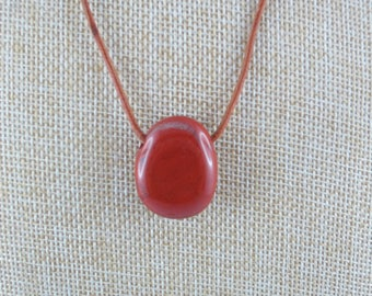 Red cord with Jasper pendant.