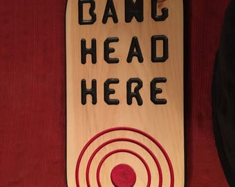 Plaque sign Bang head here