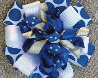Blue and White Stacked Korker Bow. It is attached to an alligator clip.