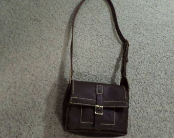 Hand stitched brown leather bag with adjustable shoulder strap