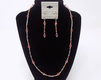 Orange and purple beaded necklace and earrings set