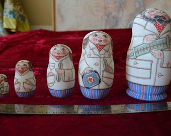 Set of 5 Russian nesting dolls.   Doctors and nurses.  Finely painted by hand with a matte finish.  Signed