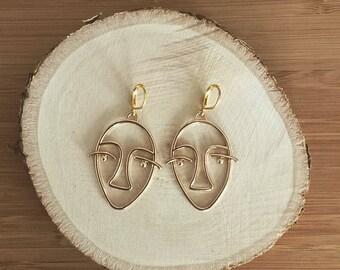 3 face earrings