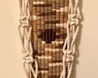 Woven macrame tapestry wall hanging.