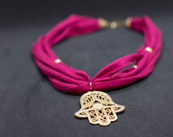 fiber multi strand necklace with Fatimas hand pendant