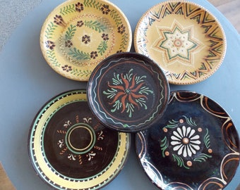 Set of 5 different vintage French folk pottery plates.