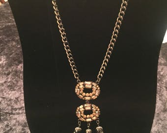 Pewter necklace with amber stone and brown tassles