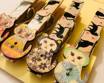 Magnetic cat pegs each with wooden cat embellishment