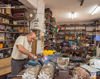 George Abu Hamameh in his shop