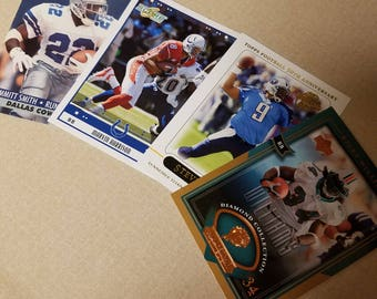 Four NFL trading cards