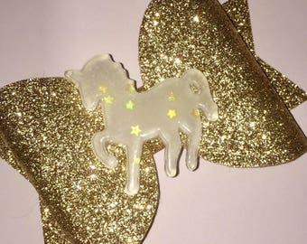 Large gold unicorn centre bow