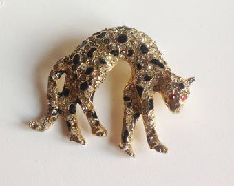 Vintage Panther Cat Jaguar brooch Costume Jewelry Rhinestones Goldtone Metal and Red Rhinestone Eyes - Fashion Accessories Collectible