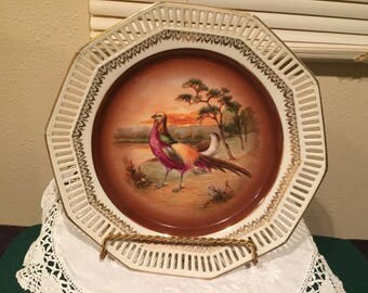 Set of fowl decorated plates