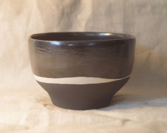 Black on black medium noodle bowl. Made from white stoneware and finished in black satin and matt glazes with a natural stoneware streak