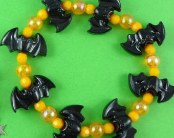 Black bat Halloween bracelet, stretchy bracelet, stretch bracelet, black and orange, spooky creepy scary, vampire bat, holiday jewelry