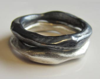Set of two organic sterling silver rings, one silver and one dark grey