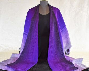 Hand woven, cotton ruana shawl, in a purple, black, and grey color  blend,