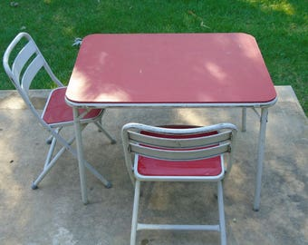 Vintage child's white metal card/ picnic/ craft table and 2 metal folding chairs with red vinyl top and seat