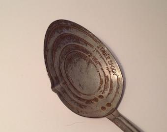 Vintage metal measuring spoon and bottle opener