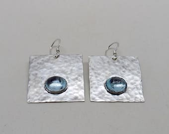 Blue topaz  earrings set in sterling silver.