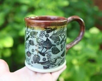 Stoneware Mug with Birds and Orange Speckle Glaze