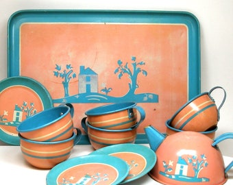 40s Tin Toy Tea Set, Blue & white house on pink, 12 pieces Cups, plates, saucers and tray.