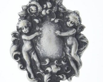 Brass stamping Cherubs  , victorian motif ,  sold by each 04226AS