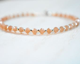 peach moonstone bracelet with sterling bead detail. delicate peach moonstone with sterling silver beads. pale peach and silver bracelet