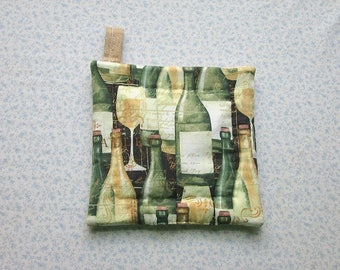 green and beige bottles of wine with beige backs hand quilted insulated potholder with loop to hang