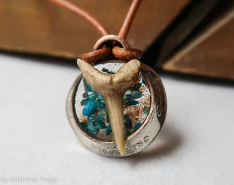Sharks tooth set in hand-hammered Oklahoma state quarter, backed with turquoise and Oklahoma red dirt