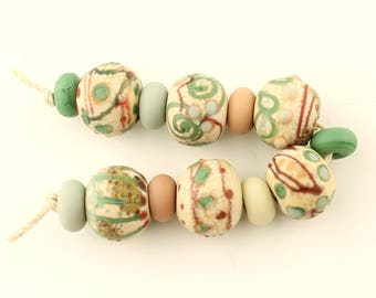 Handmade Lampwork Glass Bead Set, Rustic, Etched Matte Organic Set of 13 in Green, Rust, Ivory