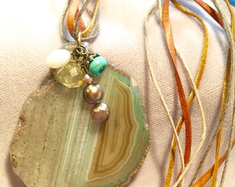Agate Slice, with bead drops pendant necklace on leather and cords,in shades of sage green and cream and brown