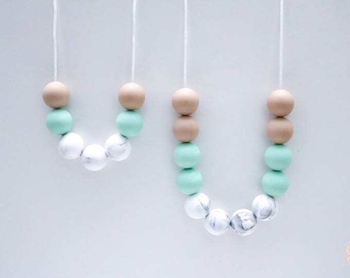 Sadie Mum and Bub set Marble and Mint Silicone Sensory Necklaces.