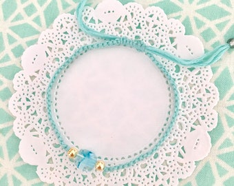 light blue pastel macrame friendship bracelet with acrylic bead accent