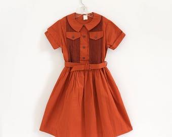 """Vintage 1960s Girls Size 8-10 Shirt Dress Deadstock, Burnt Orange Cotton Gathered Skirt Belted, bust 31"""" length 32"""""""