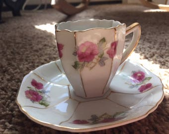 Vintage tea cup with painted wild roses