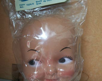 Vintage Packaged Brown Skin Thin Plastic Doll Dimple Face