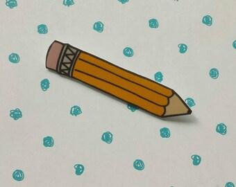 Yellow pencil brooch